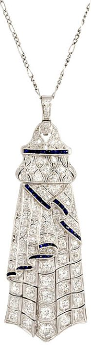 Art Deco diamond and sapphire pendant necklace.  An Art Deco sautoir comprised of a diamond chain suspending a synthetic sapphire and diamond pendant, in platinum. Approximate total diamond weight, including chain 5.08 carats. Via 1stdibs.