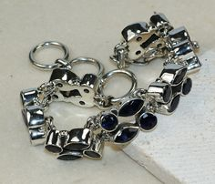 Iolite Faceted bracelet designed and created by Sizzling Silver. Please visit  www.sizzlingsilver.com. Product code: BR- 8403