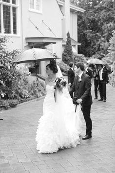Bride and groom undeterred by the rain! Villa Marco Polo Inn Victoria BC / Victoria & Vancouver Island Weddings
