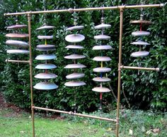 "Aquaggaswack, Curtis Settino    The first version of the Aquaggaswack, built in 1996, only had about 18 pot lids and was narrower (It didn't have the outer sections). This second version, revamped in 1998, has 29 pot lids representing a majority of the notes in an octave, plus some quarter-tones. The center lids have mostly ""bell""-like tones and the outer sets have a more ""gong""-like tone. All the lids were obtained from thrift stores and friends."