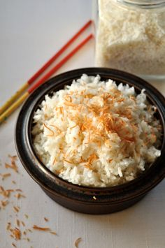 No more sticky rice! This Thai Coconut Rice turns out perfectly every time. So easy! Made with Jasmine rice, this dish has a subtle coconut flavour. This recipe hasn't failed me yet! Thai Coconut Rice, Coconut Sticky Rice, Toasted Coconut, Coconut Milk, Thai Rice, Thai Recipes, Rice Recipes, Side Dish Recipes, Cooking Recipes