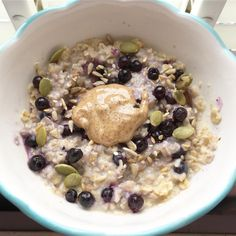 Porridge with blueberries, raisins, seeds and coconut almond butter  perfect way to start the holiday- I can't believe exams are finally…