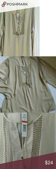 NWT Joseph A, khaki tunic blouse XXL Nice neutral khaki beige tunic blouse by Joseph A. New with tags. 100% viscose. Versatile and casual but nice quality with pretty embroidery design and peekaboo at chest panel and armholes. Layer for fall under jacket over skinny jeans or leggings. Size is XXL. Joseph Allen Tops Tunics