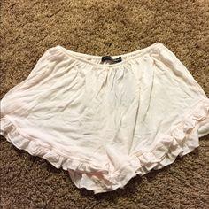Brandy Melville light pink Vodi shorts Brand new light pink Vodis • no trades Brandy Melville Shorts