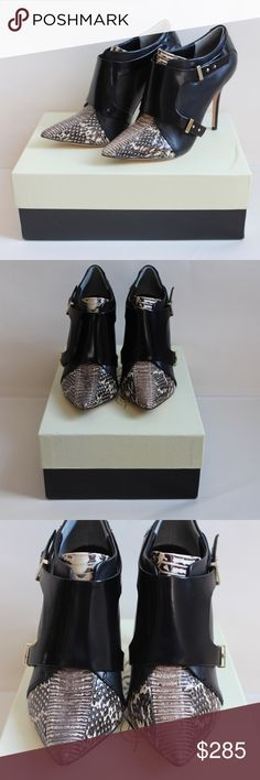 Rachel Roy Alena Snakeskin Booties These unbelievably chic Rachel Roy Alena booties feature black leather, black and white snakeskin tips and tongues, silver toned hardware, and gorgeous wide black leather pieces harnessed across the vamp of the booties.  The bottoms are also leather.  These gorgeous booties literally make you gasp!  Includes dust bag and box.  Size 6M.  Approximately 3.5 - 3.75 inch heels. Pre-owned, in brand new condition, never been worn. Rachel Roy Shoes Ankle Boots…
