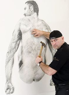 Marcus Levine - slaughtering an artist in the literal sense. He creates his paintings by nailing a white wooden panel. At his latest series of paintings exhibited in a gallery in London, Marcus has spent more than 50 000 pieces of iron.