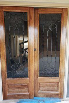 Como. Wood and Wrought Iron Door