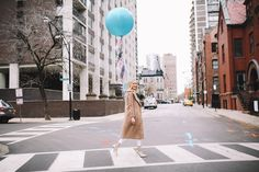 Winter whites and a giant, bright balloon