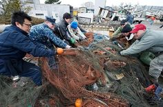 110321-N-9436A-099 HACHINOHE, Japan (March 21, 2011) Cryptologic Technician (Collection) 2nd Class Gregory Allison, left center, from Glen Burnie, Md., helps local volunteers haul a net filled with debris during relief efforts in Hachinohe. More than 130 volunteers from Misawa Air Base and members of the French army and fire department assisted in a cleanup effort in the northern Japanese city that was devastated by a 9.0 magnitude earthquake and subsequent tsunami on Japan's eastern…
