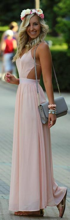 Super cute pink dress and flower crown and curly hair and bag Dont like the huge cut out though