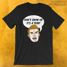 Don't Grow Up It's A Trap T-Shirt  ---  Irony And Sarkasm Novelty: This Funny Sarkasm Meme Men Women Kids T-Shirt would make an incredible gift for Youngster, Lifestyle And Funny Sayings fans. Amazing Don't Grow Up It's A Trap Tee Shirt with Original Pop Art Cartoon design. Act now & get your new favorite Irony And Sarkasm shirt or gift it to family & friends. Stay young forever! Slip on this Dont Grow Up Its A Trap T shirt with a charmingly funny warning statement be