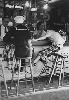 Peter Stackpole, A sailor on shore leave sitting at a soda fountain with his girlfriend, San Diego, California, USA, 1937.