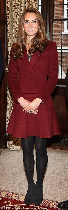 Lady in red: The Duchess of Cambridge glowed in a burgundy wool double-breasted skirt suit by French label Paule Ka during her visit to the Middle Temple in London