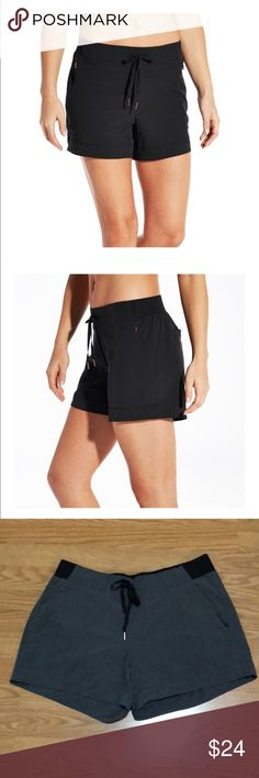 Calia L grey Anywhere Cuff Shorts w/zip pockets Anywhere drawstring cuff shorts. The shorts are in grey, and have back patch pockets and front zip pockets. Elastic waist. Zipper pulls and drawstring toggles are in rose gold. CALIA by Carrie Underwood Shorts