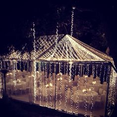 Night wedding reception, clear tent canopy, draped in twinkle lights