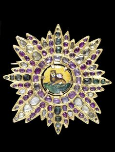 Persia | Early gem-set gold breast star of the Qajar Order of the Lion and Sun; gold, diamonds, emeralds, rubies, enamel. ca. 1830 | Est 12'000 - 15'000£ ~ (Oct '14)
