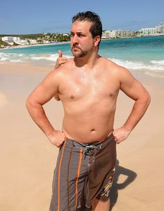 The Aquarius with shirtless chubby body on the beach