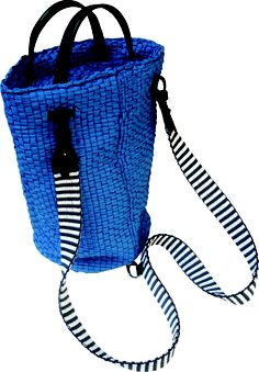Settebello backpack in handwoven fabric ribbon blue. leather handle and details