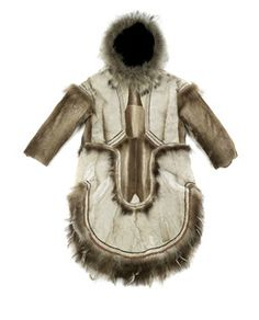 Young woman's fancy parka.  U-shaped bottom edge is a traditional feminine style that is no longer made.  Reindeer, wolverine trimmed.