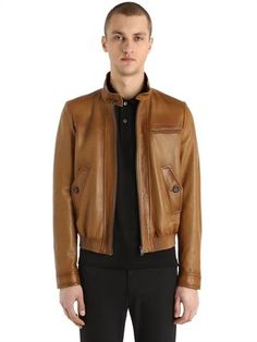 PRADA, Waxed light nappa leather bomber jacket, Brown, Luisaviaroma - Prima Linea . Collar with button closure . Raglan sleeves. Front zip closure . Button cuffs. Elastic leather hem . Back storm flap. Elbow patches . Waxed areas may vary . Logo details. One breast zip pocket . Two front button flap pockets . One internal button pocket . One internal welt pocket . Lined . Length: 63cm. Sample size: 48