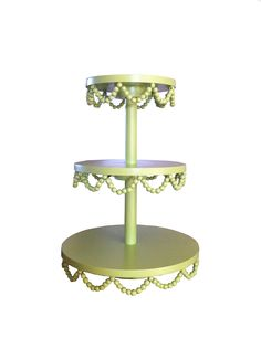 Use recycled Mardi Gras beads to decorate a whimsical beaded edge cupcake stand. Inspired by this Cupcake Tree made by Olivia Dru as seen on Etsy.