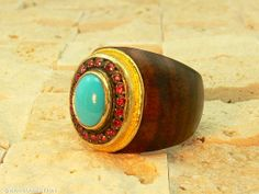 Wood ring with turquoise and rubies