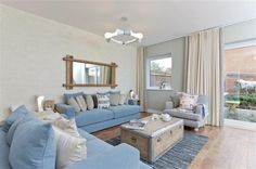 Lovely living room, nice change to the usual impractical white sofas