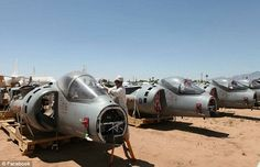 Sorry ending: RAF Harrier jets languishing in the Arizona desert after being sold off to the US for a cut-down price