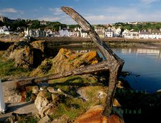 Portpatrick, The Rhins of Galloway, Cairnryan, Stranraer, Dumfries and Galloway, Scotland. Anchor on Dorn Rock looking across bay to sea front hotels and house