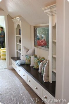 clever use of space in hallway and under sloped ceilings!! #upstairshallwayideas #hallwayideassmall