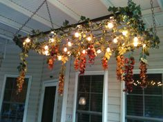 The porch chandelier I made for our deck out of a crib box spring