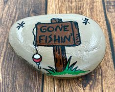 gone fishing painted rock ooak art garden father Painted River Rocks, Painted Rocks Craft, Hand Painted Rocks, Painted Garden Rocks, Painted Pebbles, Painted Stones, Rock Painting Patterns, Rock Painting Ideas Easy, Rock Painting Designs