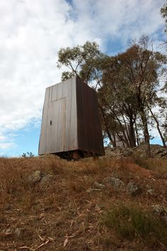The Ultimate Australian Hut - Habitus Living - The long-drop toilet behind the main hut is down the hill and has just three walls and a door opening on to truly spectacular views. Inside, there is just a wide, single piece of hardwood for a seat with a carved hole.