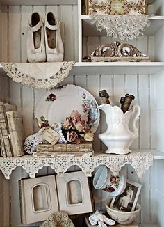 shelves decorated w/linens & lace & beautiful things)Rene's genius at Miss Gracie's House blog