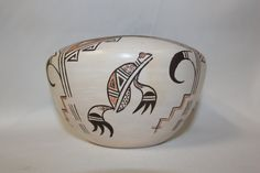 """Hopi Pottery Jar 74. Description: Ca. 1980's, Original design poly'chrome jar with black rim and stylized frog and avian forms. Good condition, some scratches/abrasions. 3-3/4"""" x 6"""". Claudina is Hopi,"""