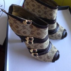 Rocawear heels Brown rocawear heels with gold zipper in back Rocawear Shoes Heels
