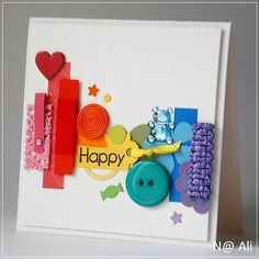 bright and beautiful card ... lovely montage of scraps ... knotted ribbon, coilded string, die cut leftovers, stray buttons ... like the groupings of colors that keeps the band of stuff from being a choatic mish mash ...