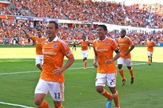 Brad Davis and Brian Ching running over towards the SS to celebrate the first goal in BBVA