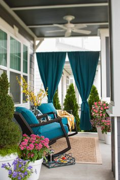 Add privacy to your porch with panels of rich blue Sunbrella outdoor fabric.