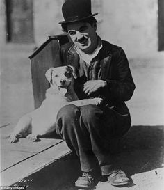 English comic actor Charlie Chaplin - with Mutt, the dog who played Scraps in the silent comedy 'A Dog's Life', Chaplin's first film for First National Films, (Photo by FPG/Archive Photos/Getty Images) Charlie Chaplin, Silent Comedy, Silent Film, Golden Age Of Hollywood, Old Hollywood, Charles Spencer Chaplin, Douglas Fairbanks, Dog Life, History