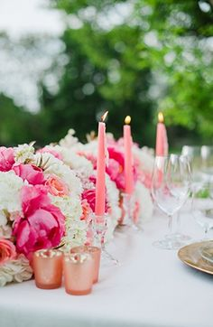 Table Decor Tip: Summer pink wedding decor #candles #florals #salmon #pink #decor #details #ideas #tablescape  Photo by: Brittany Lauren Photography on Glamour & Grace