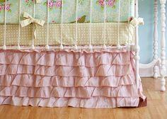Pink Ruffled Crib Skirt and layered bedding