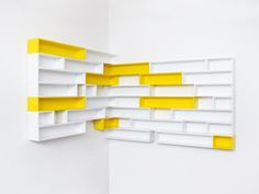 Like the idea of shelving that flows through the corner on to the next wall