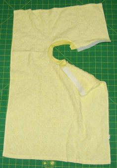 "Hand Towel Baby Bib  Debbie Colgrove:   *Materials Needed:   Hand towel or finger towel  Hook and Loop Tape (Velcro)  10"" by 2 1/2"" of Ribbing  Thread    *Note: Neck opening and ribbing may be adjusted to make an adult or older child bib. [click for complete instructions]"