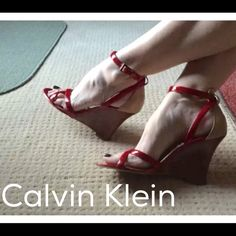 "CALVIN KLEIN reD beiGe leather wedge heels Sz 8.5 CALVIN KLEIN reD beiGe leather wedge heels Sz 8.5. style: YARRIN. 3.75"" wood heel. Pretty red patent straps, beige leather heel cup, adjustable straps. Calvin Klein Shoes Heels"
