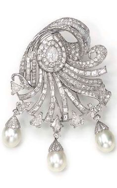 A CULTURED PEARL AND DIAMOND BROOCH  Designed as a circular, baguette and pear-shaped diamond scroll, the outer edge trimmed with fancy-shaped diamonds, suspending three detachable cultured pearl drops, measuring approximately 12.30 mm, each with a diamond-set cap, mounted in platinum