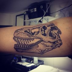 A dot work tattoo of a dinosaur skull by Gregorio Marangoni « « Ratta Tattoo