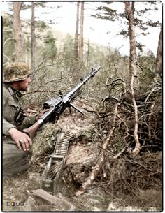 Gebirgsjäger with an MG.34 in Saltdal, Nordland. 24th May 1940 (Colourised by Doug) Look at how the bipod is mounted. Interesting.