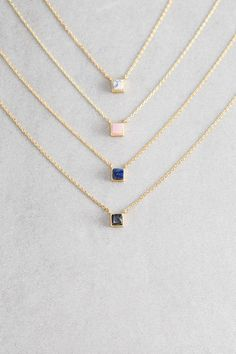 Gold and marble stone cube charm necklace.