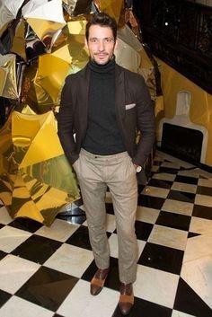 David Gandy wearing Dark Brown Wool Blazer, Black Turtleneck, Beige Wool Dress Pants, Dark Brown Leather Oxford Shoes